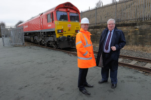 Port Director Matthew Hunt and Transport Secretary Patrick McLoughlin pause for photos in front of DB Schenker loco 66001 at the entrance to Port of Sunderland.  (Picture Paul Young)